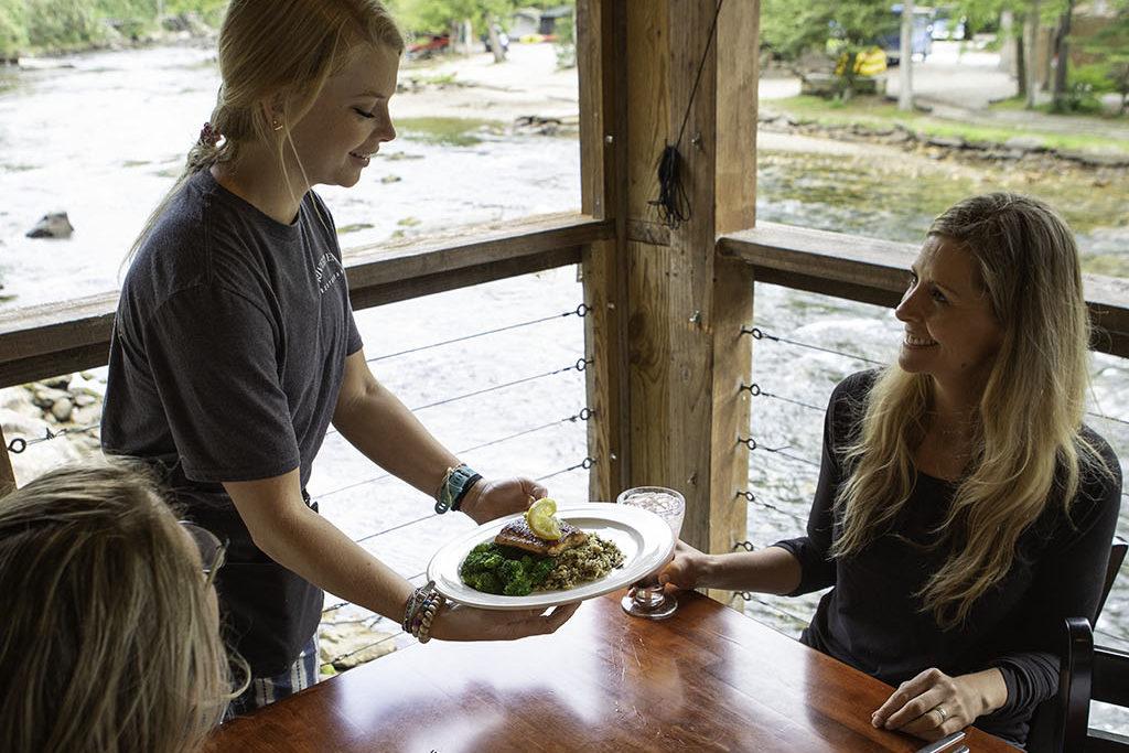 Waiter serving food at River's End Restaurant